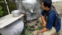 Sebuah batu yoni yang selama puluhan tahun dijadikan landasan padasan oleh warga Dukuh Precet, Desa Girimargo, Miri, Sragen. (Solopos.com/Moh. Khodiq Duhri)