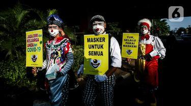 Aksi Badut Indonesia Kampanyekan Penggunaan Masker
