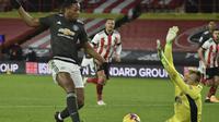 Anthony Martial mencetak gol pada pertandingan Liga Inggris antara Sheffield United dan MU di stadion Bramall Lane di Sheffield, Inggris, Kamis, 17 Desember 2020. Manchester United memenangkan pertandingan 3-2. (Foto AP / Rui Vieira, Kolam)