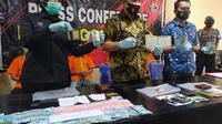 Akhir pelarian empat pencuri yang berhasil menggasak uang senilai ratusan juta rupiah milik nasabah Bank BTN Gorontalo (Foto:Arfandi ibrahim/Liputan6.com)