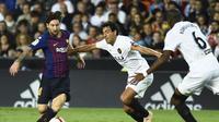 Lionel Messi selamatkan muka Barcelona lawan Valencia (JOSE JORDAN / AFP)