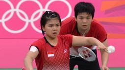 Pertama kali tampil di Olimpiade adalah saat Olimpiade London 2012, Inggris. Greysia Polii saat itu berpasangan dengan Meiliana Jauhari yang mulai dipasangkan sejak Januari 2010. (Foto: AFP/Adek Berry)