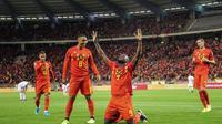 Striker Timnas Belgia, Romelu Lukaku, berselebrasi setelah menjebol gawang San Marino. Belgia menang 9-0 pada laga kualifikasi Piala Eropa 2020 di Brussel (10/10/2019)