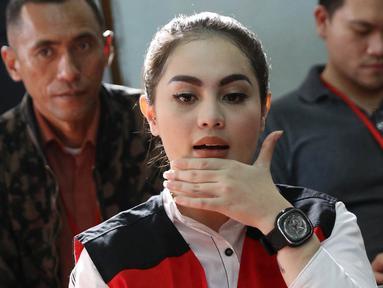 Aktris Jennifer Dunn menjalani sidang lanjutan kasus narkoba di PN Jakarta Selatan, Senin (14/5). Jennifer didakwa tiga pasal sekaligus. (Liputan6.com/Immanuel Antonius)