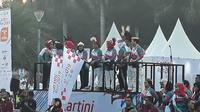 Ibu Negara Iriana Joko Widodo melepas ribuan peserta Kartini Run 2019 di Silang Monas, Jakarta Pusat, Minggu (7/4/2019). (Liputan6.com/Nafis)
