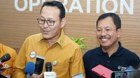 Direktur Utama BPJS Kesehatan Fachmi Idris menerima Menteri Kesehatan RI Terawan Agus Putranto saat berkunjung ke kantor BPJS Kesehatan pada Jumat (25/10/2019). (Dok Humas BPJS Kesehatan)