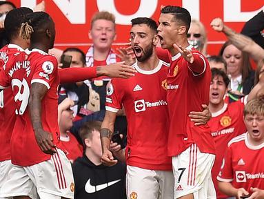 Termasuk dua golnya saat Manchester United menang 4-1 atas Newcastle United (11/9/2021), Cristiano Ronaldo telah mencetak 86 gol bersama Setan Merah di Liga Inggris. The Magpies pun tercatat sebagai satu dari lima tim yang paling sering dijebol CR-7. Yang lain? (Foto: AFP/Oli Scarff)