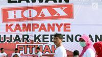 Aparatur Sipil Negara dari Kemendagri dan BNPP saat apel bersama lawan kampanye hoax dan berujar kebencian di lingkungan Kemendagri dan BNPP di Lapangan Monas, Jakarta, Jumat (15/2). Apel dipimpin Mendagri, Tjahjo Kumolo. (Liputan6.com/Helmi Fithriansyah)