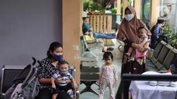 Orangtua menunggu mendapat layanan imunisasi untuk bayinya di Puskesmas Karawaci Baru, Tangerang, Banten, Rabu (13/5/2020). Pelayanan imunisai sesuai jadwal ini diberikan kepada bayi untuk menambah kekebalan imun tubuh. (Liputan6.com/Angga Yuniar)