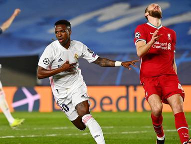 Penyerang muda asal Brasil, Vinicius Junior, memborong dua gol ke gawang Liverpool pada laga Leg pertama Liga Champions. Gol tersebut dicetak pada menit ke-27 dan Menit ke-65. (AFP/Gabriel Bouys)