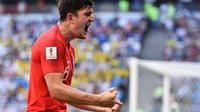 Ekspresi kebahagiaan bek Timnas Inggris, Harry Maguire usai menjebol gawang Swedia pada perempat final Piala Dunia 2018. (Fabrice COFFRINI / AFP)