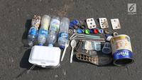 Sampah plastik yang dikumpul oleh relawan dalam gerakan bersih sampah plastik di kawasan Car Free Day, Jakarta, Minggu (21/10). Gerakan tersebut untuk meningkatkan kesadaran masyarakat mengenai ancaman sampah plastik bagi Bumi. (Liputan6.com/Angga Yuniar)