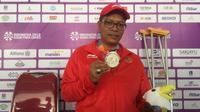 Pecatur putra Indonesia, Maksum Firdaus, berhasil meraih dua medali perak di Asian Para Games 2018. (Bola.com/Benediktus Gerando Pradigdo)