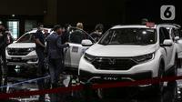 Suasana pameran IIMS Hybrid 2021 di JiExpo Kemayoran, Jakarta, Jumat (16/4/2021).  Pemerintah memberikan prioritas terhadap pengembangan industri otomotif agar bisa lebih berdaya saing global sesuai dengan sasaran pada peta jalan Making Indonesia 4.0. (Liputan6.com/Johan Tallo)
