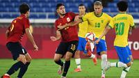 Timnas Brasil meraih kemenangan 2-1 atas Spanyol pada partai puncak cabang olahraga sepak bola Olimpiade Tokyo 2020 di International Stadium Yokohama, Sabtu (7/8/2021) malam WIB. Kemenangan ini membuat Brasil berhak atas medali emas. (AFP/MARTIN BERNETTI)