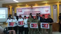 Empat paslon Pilkada Palembang mendapatkan nomor urut dengan pengawalan ketat pihak kepolisian (Liputan6.com / Nefri Inge)