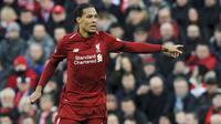 5. Virgil van Dijk (Liverpool) - Benteng tangguh The Reds ini menjadi satu di antara aktor utama keberhasilan Liverpool musim lalu. Bek timnas Belanda itu kemungkinan mendapatkan nilai 91 di FIFA 20. (AP/Rui Vieira)