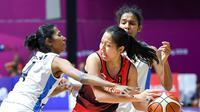 Timnas basket putri Indonesia lolos ke babak perempat final Asian Games 2018 setelah mengalahkan India dengan skor 69-66 pada pertandingan yang digelar di Hall Basket Gelora Bung Karno, Kamis (23/8/2018). (INASGOC/Rocky Padila)