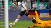 Lukas Nmecha mencetak gol tunggal kemenangan Timnas Jerman atas Portugal pada laga final Euro U-21 2021 di Stadion Stozice, Senin (7/6/2021). (AP Photo/Darko Bandic)