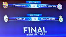 Monitor menunjukkan gambar hasil drawing babak semifinal Liga Champions. (AFP)