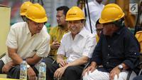 Senyuman Setya Novanto di peresmian pembangunan Gedung Panca Bakti DPP Golkar di Jakarta, Minggu (12/11). (Liputan6.com/Faizal Fanani)
