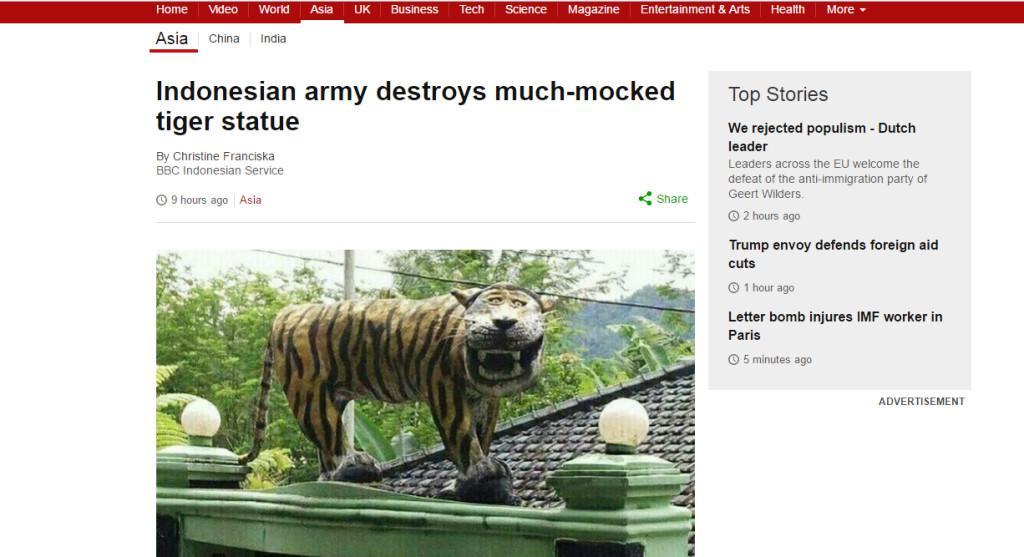 Patung macan nyengir juga jadi sorotan media asing (BBC)