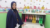 Emma menitipkan anaknya di Taman Pengasuhan Anak Serama Kementerian Kesehatan RI. (Liputan6.com/Fitri Haryanti Harsono)