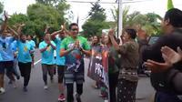 Sandi Diajak Ngopi Pendukung Jokowi di Bali