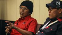 Politikus PDI Perjuangan Aldian Napitupulu (kiri) saat menjadi pembicara dalam serial diskusi dalam rangkaian Kongres V PDIP di Sanur, Bali, Jumat (9/8/2019). Diskusi tersebut membahas Demokrasi Arus Bawah (Perlawanan Terhadap Rezim Otoriter). (Liputan6.com/Johan Tallo)