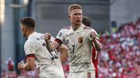 Selebrasi pemain Belgia, Kevin De Bruyne usai menjebol gawang Denmark dalam pertandingan Grup B Piala Eropa 2020 di Parken stadium, Denmark, Kamis (17/6/2021). (Foto: AP/Pool/Wolfgang Rattay)
