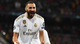 2. Karim Benzema (16 gol) - Benzema tampil produktif di laga pekan ke-29 saat Real Madrid menghadapi Valencia. Pemain asal Prancis ini mencetak dua gol dan telah mengumpulkan 16 gol saat ini. (AFP/Gabriel Bouys)