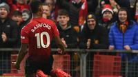 Marcus Rashford menyumbangkan satu gol sekaligus membawa Manchester United meraih kemenangan 2-1 atas Brighton and Hove Albion pada laga pekan ke-23 Premier League, di Old Trafford, Sabtu (19/1/2019). (AFP/Oli Scarff)