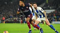 Pierre-Emerick Aubameyang mencetak gol pembuka Arsenal pada laga melawan Brighton. (AFP/Glyn Kirk)
