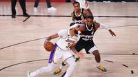 Duel Denver Nuggets melawan LA Lakers pada gim ketiga final NBA Wilayah Barat di AdventHealth Arena at the ESPN Wide World Of Sports Complex, Rabu (23/9/2020) pagi WIB. (Mike Ehrmann / Getty Images via AFP)