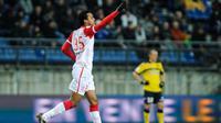 Florent Zitte saat selebrasi semasa membela AS Nancy di Liga Prancis pada 2 Maret 2013. (AFP/Sebastien Bozon)