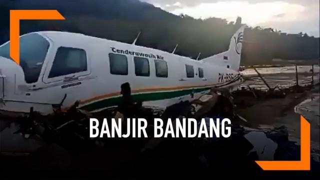 Musibah banjir bandang menerjang daerah Sentani, Papua, Hingga Minggu (17/3) pagi 42 warga dilaporkan tewas.