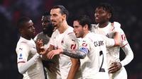 AC Milan meraih kemenangan 4-2 atas Bologna pada laga pekan kesembilan Serie A di Stadio Renato Dall'Ara, Minggu (24/10/2021) dini hari WIB. (AFP/Marco BERTORELLO)