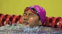 Perenang Indonesia, Syuci Indriani, usai tampil pada renang nomor 200 meter gaya bebas Asian Para Games di Stadion Aquatic Senayan, Jakarta, Minggu (7/10/2018). Syuci berhasil meraih medali perunggu. (Bola.com/Vitalis Yogi Trisna)