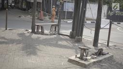 Suasana ruas jalan di kawasan Kemang, Jakarta, Minggu (12/5/2019). Rencana pembangunan fisik penataan ruang jalan atau pedestrian kawasan Kemang akan dimulai pada akhir Mei 2019 dengan tujuan menjadikan kawasan tersebut sebagai objek wisata. (Liputan6.com/Immanuel Antonius)