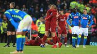 Pemain Liverpool merayakannya kemenangan tim mereka setelah mengalahkan Napoli pada matchday keenam Grup C Liga Champions di Stadion Anfield, Selasa (11/12). Gol Mohamed Salah mengantarkan Liverpool unggul atas Napoli 1-0. (Peter Byrne/PA via AP)