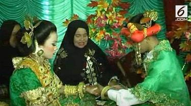 Sebuah rekaman menunjukkan pesta pernikahan pasangan di bawah umur yang terjadi di Sulawesi Barat.