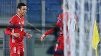Pemain muda Bayern Munchen, Jamal Musiala ketika mencetak gol ke gawang Lazio pada leg 1 babak 16 besar Liga Champions 2020/2021, Rabu dini hari WIB. (Alberto PIZZOLI / AFP)