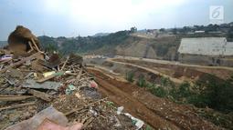 Pemandangan proyek pembangunan Bendungan Ciawi di Desa Gadog, Bogor, Jawa Barat, Kamis (22/08/2019). Bendungan Ciawi dirancang untuk mengurangi debit air yang masuk ke Jakarta. (Merdeka.com/Arie Basuki)