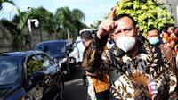 Ketua KPK, Firli Bahuri usai mengikuti Rapat Dengar Pendapat dengan Pimpinan dan Dewan Pengawas KPK dengan Komisi III DPR RI di Gedung KPK, Jakarta, Selasa (7/7/2020). Ini merupakan kali pertama RDP digelar di Gedung Merah Putih KPK. (Liputan6.com/Helmi Fithriansyah)
