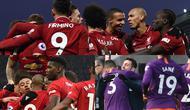 Liverpool berhasi menjaga jarak dengan Manchester City usai mengalahkan Crystal Palace 4-3 pada pekan ke-23 Premier League. Sementara itu Manchester City masih membayangi Liverpool dengan selisih empat poin saja. (Kolase Foto AFP)