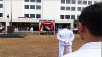 Pegawai Ditjen Pajak merayakan peringatan Hari Pajak dengan menggelar upacara bersama pada Sabtu (14/7/2018) (Foto:Liputan6.com/Ilyas I)