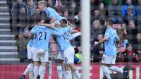 Para pemain Manchester City merayakan gol Riyad Mahrez ke gawang Bournemouth. (AFP/Glyn Kirk)