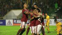 Pemain Timnas Indonesia merayakan gol pertama ke gawang Brunei Darussalam yang dicetak Hansamu Yama Pranata di Stadion Harapan Bangsa, Banda Aceh, Sabtu (2/12/2017) malam. (Bola.com/Eko Deni Saputra)