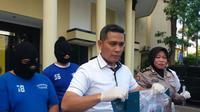 Pejabat di Kantor Imigrasi Kelas I Tanjung Perak Surabaya itu baru setahun di posisi tersebut sebelum dibui gara-gara kasus pembuatan paspor. (Liputan6.com/Dhimas Prasaja)