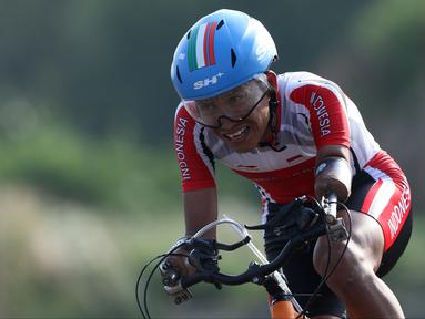 Atlet ParaCycling, Anwar Saipul saat laga di nomor Mens C3 Individual Time Trial Road Race Asian Para Games 2018 di Sirkuit Sentul, Bogor, Senin (8/10). Anwar Saipul berhasil merebut medali perak.(Www.sulawesita.com)